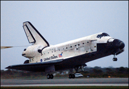 Space Shuttle landing on a runway. Courtesy of NASA.
