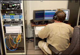 Photgraph of audio technician working on voice identification