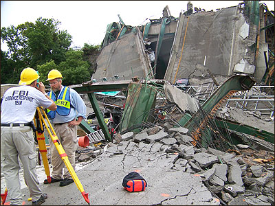 Photograph of FBI Evidene Response Team members at the scene of the bridge collapse