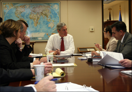 FBI Director Robert Mueller with his intelligence briefer and other senior executives.