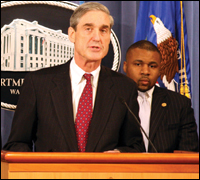 Director Robert S. Mueller was joined by civil rights leaders, including John H. Jackson, chief policy officer of the NAACP, at a press conference Tuesday in Washington, D.C.
