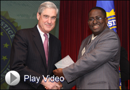 Dr. Saeed Fahia receives award (play button)