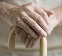 Photograph of Elderly woman's hands holding a cane
