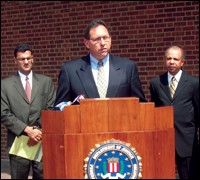 Philadelphia FBI Assistant Special Agent in Charge Brian Lynch is joined by Salam Al-Marayati, Executive Director MPAC, left, and Assistant U.S. Attorney Jeff Whitt during a May press conference in Philadelphia