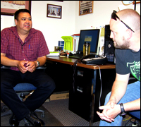 FBI Special Agent Doug Klein talks about a case with Special Agent Mike Cuny of the Bureau of Indian Affairs on the Crow reservation in Montana