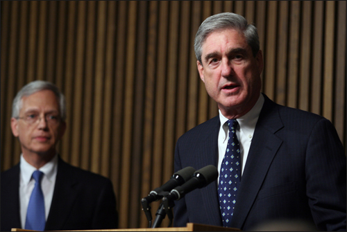 Director Mueller and NCMEC's Earnie Allen address reporters during a press conference