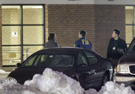 An FBI agent stands outside a Northern Illinois University lecture hall on February 14.  AP photo.
