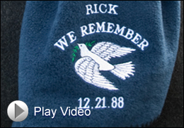 Closeup photo of memorial towel with Play Video Button