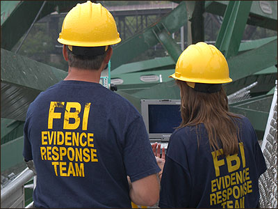 FBI Evidence Response Team members plot wreckage of the I-35W bridge that collapsed August 1 in Minneapolis