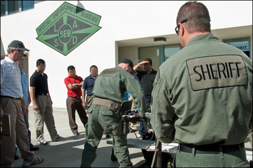 Members of the Los Angeles County Sherriff's Department SWAT team demonstrate their gear and tactics to members of the CALEE program.
