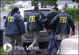 Suspect with FBI agents (Play Video)