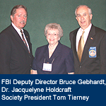 Photograph of Dr. Jacquelyne Holdcraft, Bruce Gebhardt, and Tom Tierney