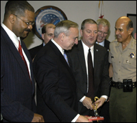 The new Joint Regional Intelligence Center opened July 27. Officials in the foreground, left to right, are Willie Hulon, head of the FBI's National Security Branch, LAPD Chief William Bratton, J. Stephen Tidwell, head of the FBI's L.A. field office, and Los Angeles County Sheriff Leroy Baca.