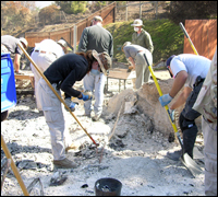 FBI evidence experts at a home destroyed by fire