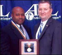 Supervisory Special Agent Kendrick Williams, left, and J. Stephen Tidwell, Assistant Director in Charge of the Los Angeles field office, during a presentation of the ADL's Sherwood Prize in February.