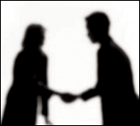 Silhouettes shaking hands