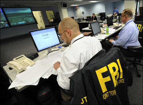 FBI agents and law enforcement partners at work in the New York operations center. AP Photo.