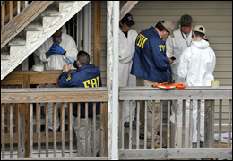 FBI personnel search a house where Shahzad lived in Bridgeport, Connecticut. AP Photo.