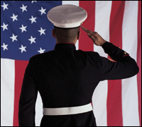 Photograph of United States serviceman saluting the American flag