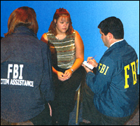 FBI agent and victim assistance specialist conduct an interview