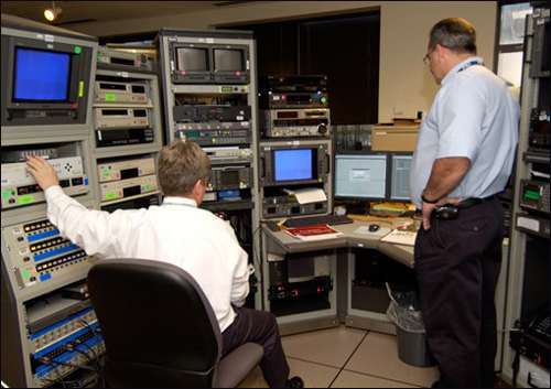 Photograph of examiners enhancing a video