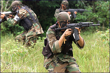 Paramilitary gunmen during a training session in Colombia.