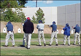 Agents firing at targets from a standing position