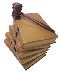 Picture of a judge's gavel sitting atop a stack of legal reference books