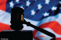 Photograph of an American Flag with a gavel in foreground