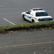 Picture of police car in a parking lot