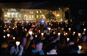 Picture of a crowd holding candles