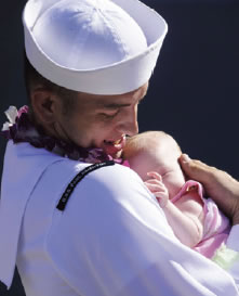 Navy officer with child